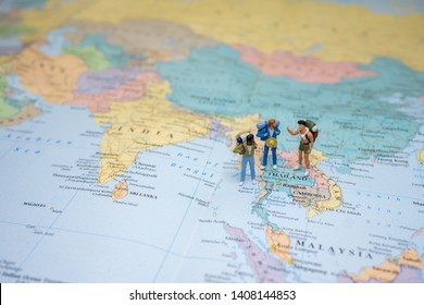 gay group or friends travel concepts. A little figure of friends backpacker or miniature gay group tourist LGBTQ stand and walk on map of Thailand in world map.