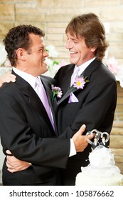 Gay male couple embracing on their wedding day.