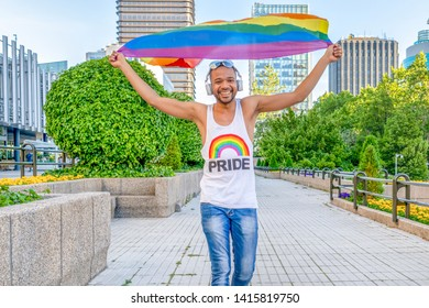gay man vindicating the right to equality with a pride flag. concept of equality and homosexuality and lgbt