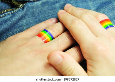Gay marriage concept with hands and rainbow rings
