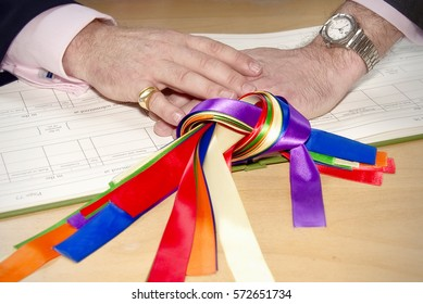 Gay marriage two men with hands on wedding certificate with rainbow ribbons
