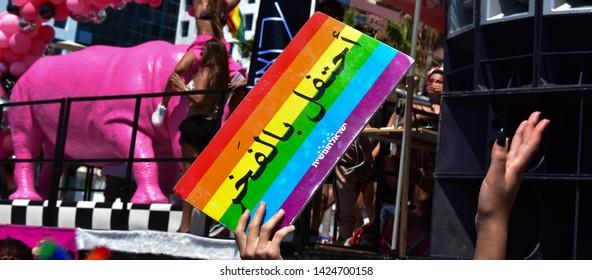 Gay panel in Tel Aviv with write in Arab : te meaning is : Keep Calm