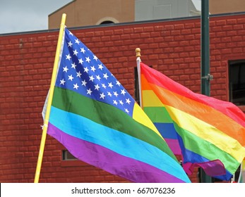 Gay pride flags seen in a street parade