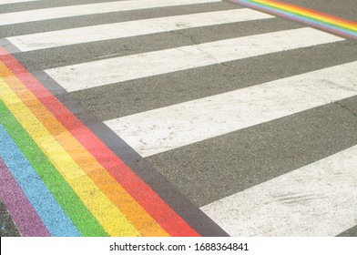 Gay Pride Month. lgbt rainbow on the pedestrian path.  Asfalt on the street, summer day.