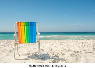 Gay pride rainbow chair at the beach