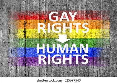 Gay Rights Are Human Rights and LGBT flag painted on background texture gray concrete