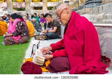 Gaya,  India - January 6, 2019 : Buddhist monks offer prayers near Holy Bodhi Tree at World Heritage Mahabodhi Temple in Bodh Gaya in Bihar northeast
