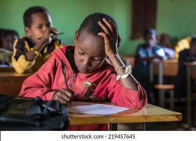 GAYO VILLAGE, ETHIOPIA - JUNE 20: Unidentified school boys take an exam in the village school on June 20, 2012 in Gayo village, Ethiopia.