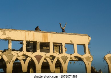 Gaza strip. 07.02.2017. Yasser Arafat International Airport. Tracers Abdullah and Jihad are practicing parkour on the top a building ruined by war.