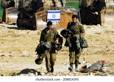 GAZA STRIP - JAN 18 2009:Israeli soldiers partially withdraw from Gaza into Israel, as both Hamas and Israel announce separate cease-fires.
