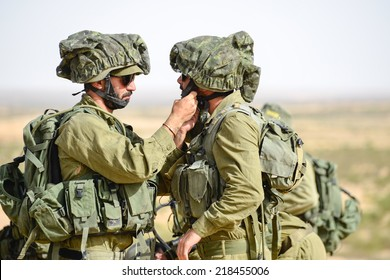 Gaza Strip/Israel -July 12th - Israeli soldiers help each other in July 12th 2014 in the fields around Gaza Strip during their army service.