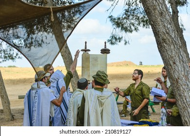 Gaza Strip/Israel -July 26th - Israeli soldiers read the scroll of Torah in July 26th 2014 in the fields around Gaza Strip during their army service.