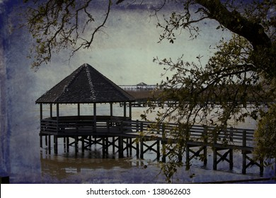 The gazebo in Currituck Heritage Park in historic Corolla, North Carolina is a popular vacation destination,  This is an artistic version of this location.