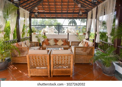 Gazebo in the garden with wicker wooden furniture with soft mattress and pillows,tropical interior in North Goa.India