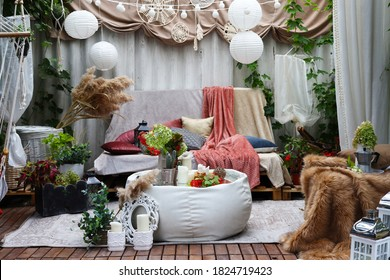gazebo interior in folk style with pillows and coffee