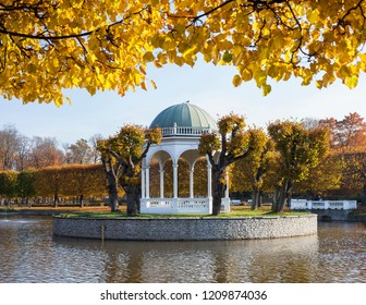 Gazebo in the middle of pond on golden autumn day. Historic Kadriorg park in Tallinn, Estonia, Europe.