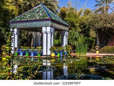 Gazebo near the pond in the majorelle garden in Marrakech, Morocco.