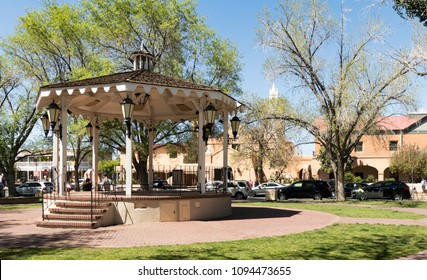 Gazebo in Old Town Albuquerque Plaza, and San Felipe de Niri Church. Old Town Albuquerque, New Mexico, USA.