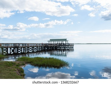Gazebo on the water in a beautiful lake in South Florida. Bright, colorful nature background