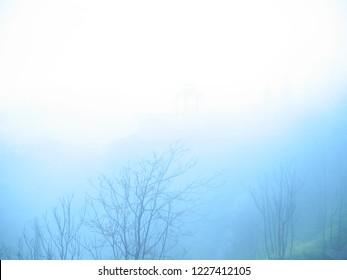 Gazebo in Spanish mountainside hidden in foggy morning haze