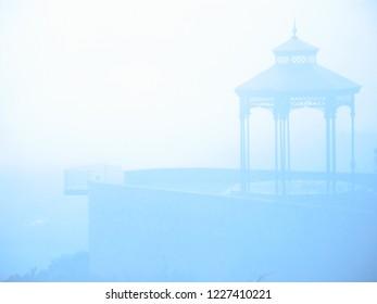 Gazebo in Spanish mountainside one foggy morning