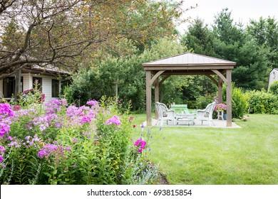 Gazebo in summer backyard very beatuful and cozy. Pergola