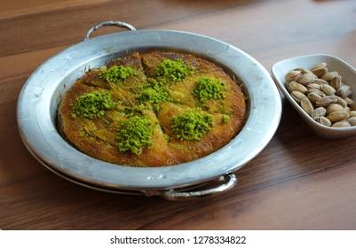 "Gaziantep's famous crispy ""kunefe"" (künefe). Traditional turkish arabic dessert. Turkish flavor with pistachio."