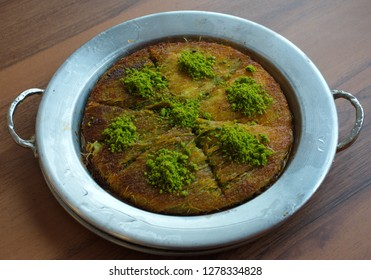 "Gaziantep's famous crispy ""kunefe"" (künefe). Traditional turkish arabic dessert. Turkish flavor with pistachio."