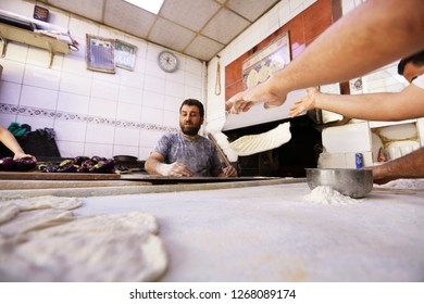 Gaziantep/Turkey - 17 October 2018 : The bakers are preparing bread in the bakery.
