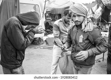 Gazipur, Delhi, India – December 25 2020 : Indian Sikh and Hindu Farmers from Punjab, Uttar Pradesh and Uttarakhand states protests at Delhi-UP Border against new farmer laws – Black and White