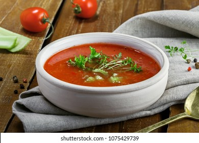 Gazpacho and ingredients on a table, vegetable soup. Delicious Spanish vegan cuisine. Close-up[ shot.