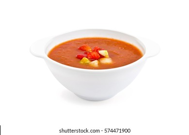 Gazpacho tomato soup in a white bowl isolated on white background