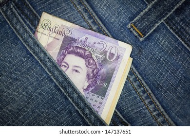 GB pounds in blue jeans back pocket