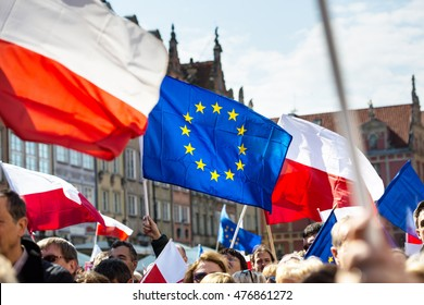 Gdansk, Poland, 05.03.2016 - people with flags of EU and Poland during demonstration in the defense of the constitution organized by Committee for the Defense of Democracy (KOD)