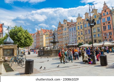 GDANSK, POLAND - 5 SEPTEMBER 2014: Fountain of the Neptune in old town of Gdansk at night. The bronze statue of Neptune made in 16th century is one the most recognizable symbols of Gdansk.