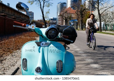 Gdansk Poland - April 17, 2019: City scooter that can be rented stands on the side of the road on the Walowa street. The inscription on the scooter: take me to rent