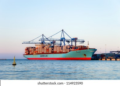 GDANSK, POLAND - APRIL 22: The Svend Maersk is currently one of the world's largest container vessels, length 347m, beam 43m, taking on board the 8 600 containers on April 22, 2011 in Gdansk, Poland.