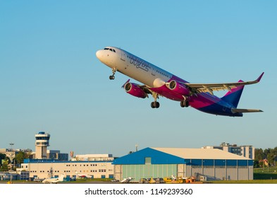 GDANSK, POLAND - AUGUST 13, 2017: Passenger airplane of Wizz Air airlines on the airstrip and start up to fly from Lech Walesa International Airport in Gdansk. Wizzair is a Hungarian low cost airline.