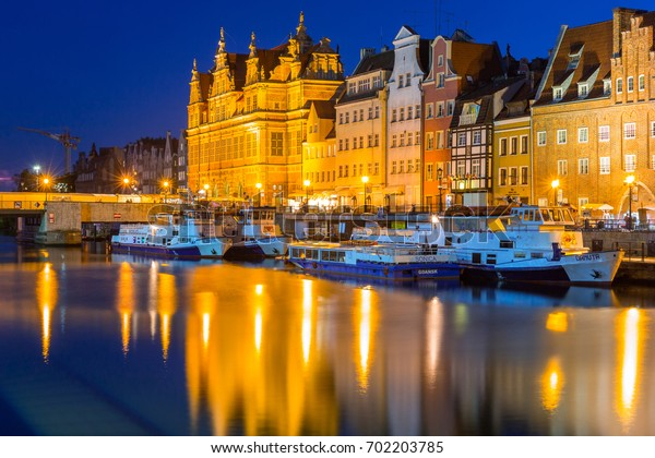 GDANSK, POLAND - AUGUST 13, 2017: Summer scenery of Motlawa river in Gdansk at night, Poland. Gdansk is the historical capital of Polish Pomerania.