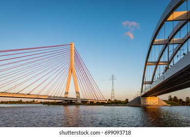 GDANSK, POLAND, AUGUST 14, 2017: Cable stayed bridge and railway bridge over Martwa Wisla river at dusk in Gdansk. Poland  Europe.