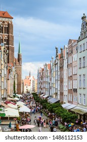 GDANSK, POLAND - AUGUST 16, 2019: view of St. Mary's Basilica and tenements at Długa Street in Gdansk