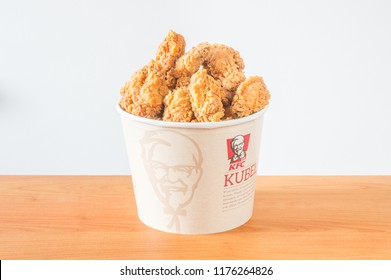Gdansk, Poland - August 24, 2018: A lots of KFC chicken hot wings in bucket of KFC (Kentucky Fried Chicken) fast food.