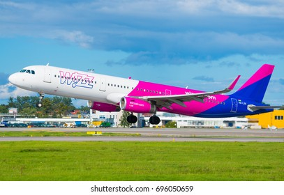 GDANSK, POLAND - AUGUST 6, 2017: Passenger airplane of Wizz Air airlines on the airstrip and start up to fly from Lech Walesa International Airport in Gdansk. Wizzair is a Hungarian low cost airline.