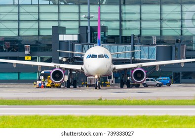 GDANSK, POLAND - AUGUST 6, 2017: Passenger plane of Wizz Air airlines on the airstrip and is ready to fly from Lech Walesa International Airport in Gdansk. Wizzair is a Hungarian low cost airline.