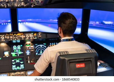 Gdansk, Poland - December 06, 2020: Instructor in flight simulator for the training of the pilots.