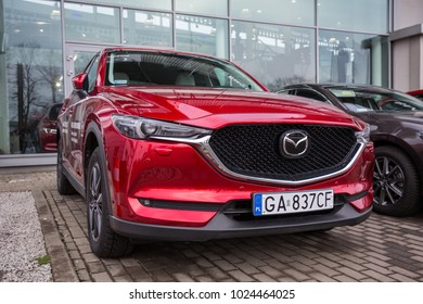 GDANSK, POLAND - FEBRUARY 13, 2018: Mazda CX-5 in the car showroom of Gdansk, Poland. Mazda CX-5 is a popular SUV car manufactured in Japan by the Mazda Motor Corporation.