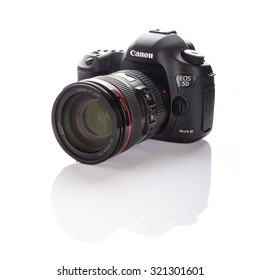 GDANSK, POLAND - FEBRUARY 18 , 2013: Canon 5D Mark III camera with 24-105mm f/4.0L IS USM lens on a white background. Canon is the world largest SLR camera manufacturer.