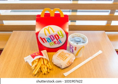 Gdansk, Poland - February 21, 2018: Happy meal with Coca-Cola, french fries and cheeseburger.