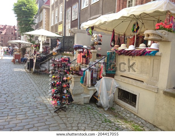 GDANSK, POLAND - JULY 07 07, 2014: Saint Mary street in old town district in Gdansk, Poland.  Souvenir street for tourists.
