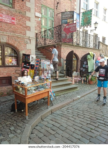 GDANSK, POLAND - JULY  07, 2014: Saint Mary street in old town district in Gdansk, Poland.  Souvenir street for tourists.